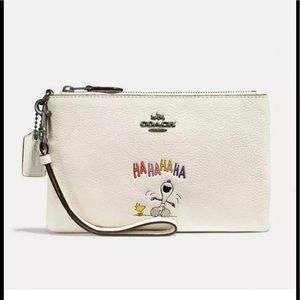 COPY - Coach x Peanuts Snoopy Zip Wristlet